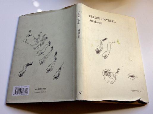 Välläst exemplar av Att bli ved, med omslag av Leif Eggren och wasabifläck.