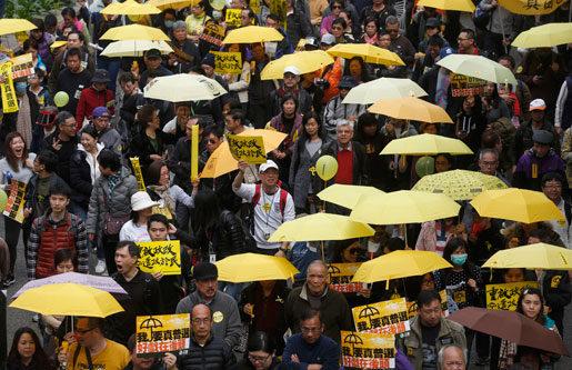 – Vi vill ha äkta allmän rösträtt. Hongkongbor demonstrerade i februari. Foto: Kin Cheung