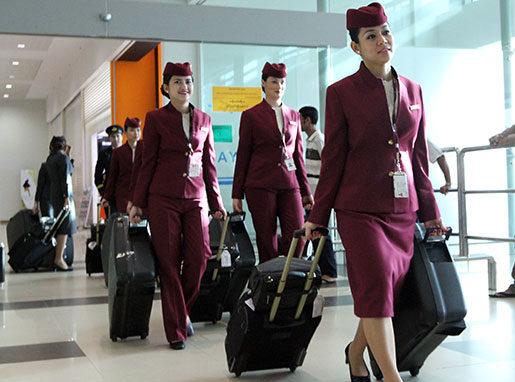 Kvinnliga anställda på Qatar airways riskerar jobbet om de blir med barn. Foto: Khin Maung Win