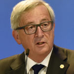 European Commission President Jean-Claude Juncker talks to the media after the emergency EU heads of state summit on the migrant crisis at the EU council building in Brussels on early Thursday, Sept. 24, 2015. European Union leaders, faced with a staggering migration crisis and deep divisions over how to tackle it, managed to agree early Thursday to send 1 billion euros ($1.1 billion) to international agencies helping refugees at camps near their home countries. (AP Photo/Martin Meissner)