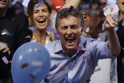 Opposition presidential candidate Mauricio Macri and his wife Juliana Awada, back left, celebrate after winning a runoff presidential election in Buenos Aires, Argentina, Sunday, Nov. 22, 2015.  Macri won Argentina's historic runoff election against ruling party candidate Daniel Scioli, putting an end to the era of  President Cristina Fernandez, who along with her late husband dominated Argentine politics for 12 years. (AP Photo/Ricardo Mazalan)