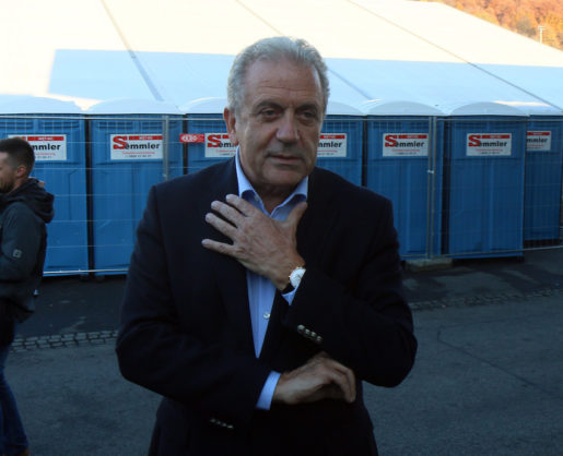 EU Commissioner for Migration and Home Affairs Dimitris Avramopoulos speaks to media during a visit with Austrian Interior Minister Johanna Mikl-Leitner at the border between Slovenia and Austria in Spielfeld, Austria, Friday, Nov. 6, 2015. The Austrian Interior Ministry says that 56,356 people applied for asylum between January and September, representing a 231-percent jump over the same period last year. (AP Photo/Ronald Zak)