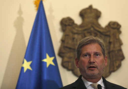 European Commissioner for European Neighbourhood Policy and Enlargement, Johannes Hahn speaks during a press conference after talks with Serbian Prime Minister Aleksandar Vucic, unseen, in Belgrade, Serbia, Friday, Sept. 25, 2015.  Hahn said Friday that the problem with Croatia accusing Serbia of busing migrants to Croatia's border, can be solved only with Croatia reopening its border. (AP Photo/Darko Vojinovic)