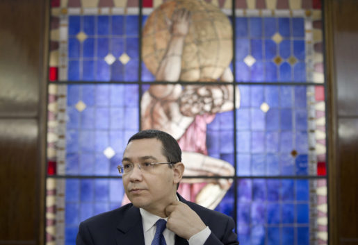 FILE - In this Tuesday, June 9, 2015 file photo Romanian Prime Minister, Victor Ponta, adjusts his collar during a meeting with foreign media at the government headquarters in Bucharest. Romanian Prime Minister Victor Ponta has resigned following protests over the deadly Bucharest nightclub fire. (AP Photo/Vadim Ghirda, File)