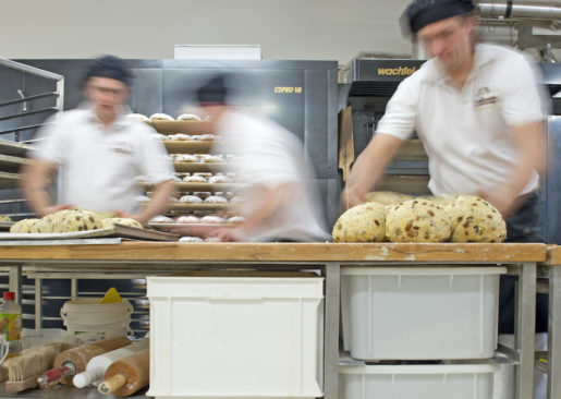 "Workers form dough for the Christmas cake Original Dresdner Christstollen (Dresden Stollen) in the Morenz bakery in Dresden, eastern Germany, Thursday, Nov. 21, 2013. The stollen cakes contain dried fruit and are covered with sugar, usually eaten during the Christmas season. The Morenz bakery belongs to the German Association for the Protection of the Dresden Christmas Stollen which allows bakeries to produce and sell this cakes worldwide under the registered trademark""Echter Dresdner Christstollen"". (AP Photo/Jens Meyer)"