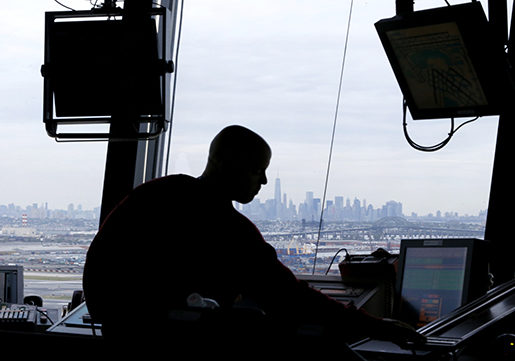 An air traffic controller works in the tower at Newark Liberty International Airport, Thursday, May 21, 2015, in Newark, N.J. The Federal Aviation Administration demonstrated to media a system, called Data Comm, that will allow for electronic communication between air traffic controllers and pilots aimed to cut delays. (AP Photo/Julio Cortez)