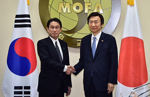 South Korean Foreign Minister Yun Byung-Se, right, and his Japanese counterpart Fumio Kishida pose for a photo at the start of their meeting at Foreign Ministry in Seoul Monday, Dec. 28, 2015. The foreign ministers met Monday to try to resolve a decades-long impasse over Korean women forced into Japanese military-run brothels during World War II. (Jung Yeon-je/Pool Photo via AP)