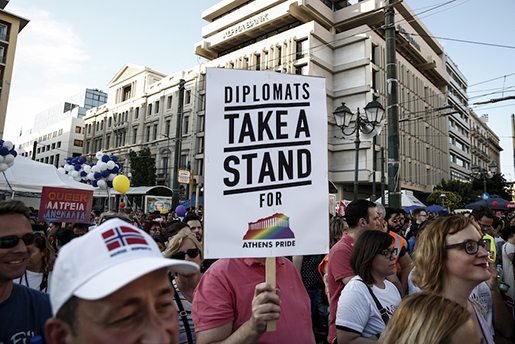 A protester holds a placard during an annual Gay Pride rally in Athens, Greece, on Saturday, June 13, 2015. The government has promised to legalize same-sex civil partnership this year and had issued draft legislation for consultation. In a 2013 ruling, the Council of Europe's Court of Human Rights condemned the country for failing to include same-sex couples in 2008 legislation that introduced civil partnerships.(AP Photo/Yorgos Karahalis)