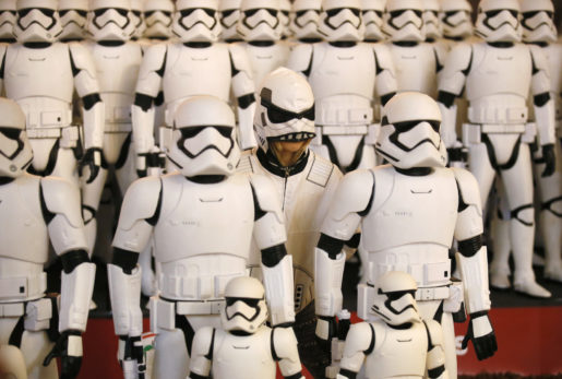 IMAGE DISTRIBUTED FOR JAKKS - Ten year old Emilia Magill, from La Crescentia, Calif,Over 100 JAKKS BIG-FIGS Stormtrooper action figures are seen as a part of an installation at The Americana at Brand for the opening of Star Wars: The Force Awakens, Thursday, Dec. 17, 2015, in Glendale, Calif. The new BIG-FIGS Stormtroopers, inspired by the latest Star Wars movie, are available now at all major retailers. (Photo by Danny Moloshok/Invision for JAKKS/AP Images)