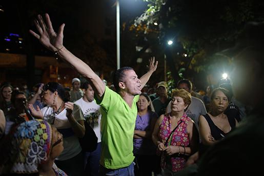 Oppositionens anhängare firar i Caracas. Foto: AP Photo/Ariana Cubillos