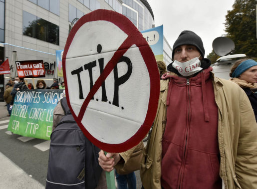 Protestors demonstrate against the free trade agreements TTIP (Transatlantic Trade and Investment Partnership) and CETA (Comprehensive Economic and Trade Agreement) during an EU summit in Brussels, Belgium on Thursday, Oct. 15, 2015. European Union heads of state meet to discuss, among other issues, the current migration crisis. (AP Photo/Martin Meissner)