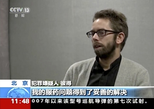 Bild från China Central Television (CCTV), där Peter Dahlinvisas upp. Foto: CCTV via AP Video