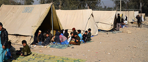 Afghan students attend school classes under tents in Jalalabad, capital of Nangarhar province, Afghanistan, Wednesday, Dec. 16, 2015. (AP Photos/Mohammad Anwar Danishyar)