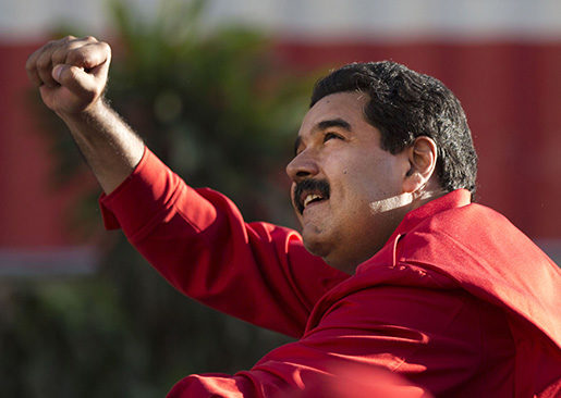 FILE - In this Dec. 1, 2015, file photo, Venezuela's President Nicolas Maduro gestures to supporters from the top of a car after the inauguration of cable car public transportation system, in the popular neighborhood of Petare, in Caracas, Venezuela. Allies of President Maduro are disputing the election of eight opposition candidates to the National Assembly, a move the opposition says seeks to undermine its landslide victory in legislative elections. On Tuesday, Dec. 29, 2015, the Supreme Court said it had received motions by losing candidates to overturn the results in several districts.(AP Photo/Ariana Cubillos, File)
