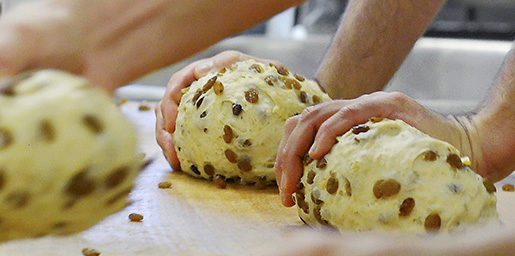 Workers form dough for the Original Dresdner Christstollen cake (Dresden Christmas Stollen) in the bakery Wippler in Dresden, eastern Germany, Monday, Nov. 12, 2012. The company has orders for cakes from European countries as well as the US , Australia, China and Japan. The family business has been running for over 100 years (AP Photo/Jens Meyer)