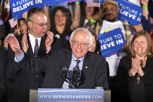 Democratic presidential candidate, Sen. Bernie Sanders, I-Vt, smiles as he speaks at his primary night rally Tuesday, Feb. 9, 2016, in Concord, N.H. (AP Photo/J. David Ake)