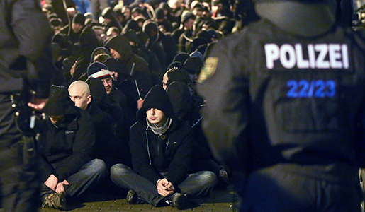 About 250 hooligans are encircled by the local police after riots following a demonstration of Leipzig's Europeans against the Islamization of the West (LEGIDA), a group linked with the PEGIDA movement, in Leipzig, eastern Germany, Monday, Jan. 11, 2016. in Leipzig. (Jan Woitas, DPA via AP)