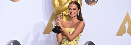 ** EMBARGOED AT THE REQUEST OF THE ACADEMY OF MOTION PICTURE ARTS & SCIENCES FOR USE UPON CONCLUSION OF THE ACADEMY AWARDS TELECAST ** Alicia Vikander poses with the award for best actress in a supporting role for ìThe Danish Girlî in the press room at the Oscars on Sunday, Feb. 28, 2016, at the Dolby Theatre in Los Angeles. (Photo by Jordan Strauss/Invision/AP)