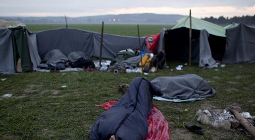 Stranded refugees sleep as they wait to be allowed to cross the Greek-Macedonian border near the northern Greek village of Idomeni, Saturday, Feb. 27, 2016. Greek officials said not a single migrant has been allowed into northern neighbor Macedonia Friday, with nearly 5,000 people waiting at or near a border crossing to be admitted. More than 20,000 migrants are stuck in Greece. (AP Photo/Petros Giannakouris)