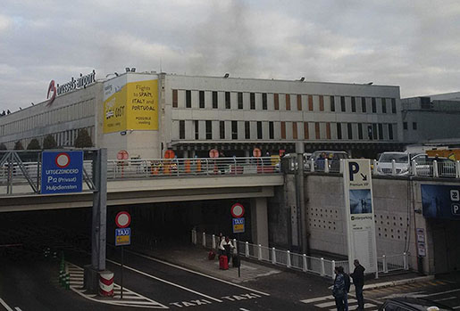 In this image provided by Daniela Schwarzer, smoke is seen at Brussels airport in Brussels, Belgium, after explosions were heard Tuesday, March 22, 2016. (Daniela Schwarzer via AP)