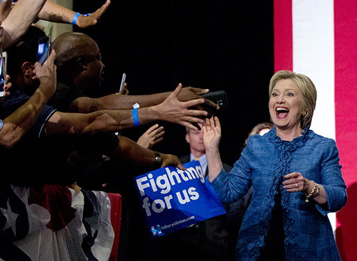 Democratic presidential candidate Hillary Clinton arrives to a cheering crowd as she arrives at an election night event at the Palm Beach County Convention Center in West Palm Beach, Fla., Tuesday, March 15, 2016. (AP Photo/Carolyn Kaster)