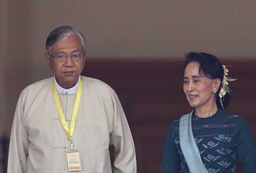 Htin Kyaw, left, newly elected president of Myanmar, walks with National League for Democracy party leader Aung San Suu Kyi in Myanmar's parliament in Naypyitaw, Myanmar, Tuesday, March 15, 2016. For years he walked alongside Nobel laureate Suu Kyi, a quiet confidant in her campaign for democracy in Myanmar. On Tuesday, with her blessing, Htin Kyaw became the country's president. (AP Photo/Aung Shine Oo)