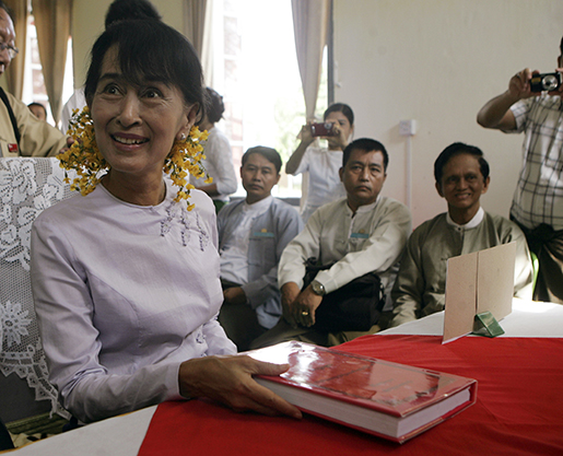 Myanmar opposition leader Aung San Suu Kyi smiles after submitting a by-election budget document to an official of the Yangon Divisional Union Election Commission office Wednesday, May 9, 2012, in Yangon, Myanmar. Suu Kyi received her first passport in 24 years Tuesday, ahead of a planned trip to Norway and Britain, An aide to Suu Kyi, Htin Kyaw, said the passport was received from the Home Ministry. (AP Photo)