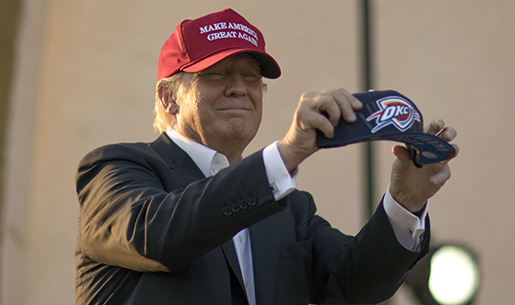 Republican presidential candidate Donald Trump holds an Oklahoma City Thunder basketball hat before speaking at a campaign rally at the Oklahoma State Fair, Friday, Sept. 25, 2015, in Oklahoma City. (AP Photo/J Pat Carter)