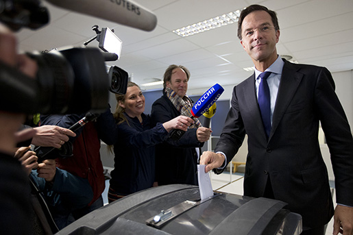 Dutch Prime Minister Mark Rutte casts his vote in a non-binding referendum on the EU-Ukraine association agreement in The Hague, Netherlands, Wednesday, April 6, 2016. The vote is seen by opponents of the 28-nation EU bloc as an opportunity to express their anger at what they consider unwanted expansionism and a lack of democratic rights for EU citizens, three months before British citizens decide in their own referendum whether to leave the EU altogether. (AP Photo/Peter Dejong)