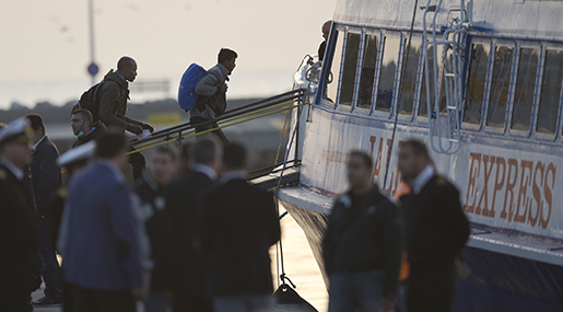 Migrants get on a ferry at the port of Mytilini in the Greek island of Lesbos, Monday, April 4, 2016, during the first day of the implementation of the deal between EU and Turkey. Under the deal, migrants arriving illegally in Greece will be returned to Turkey if they do not apply for asylum or if they make an asylum claim that is rejected.(AP Photo/Petros Giannakouris)