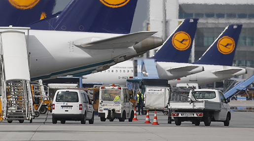FILE - In this Aug. 26, 2013 file photo Lufthansa airplanes are parked at the international airport in Munich, southern Germany. German airline Lufthansa is ordering 34 new jets from Boeing and 25 from European rival Airbus as it updates its long-haul fleet to make it more fuel efficient and lower costs. Lufthansa said the orders were worth 14 billion euros (US dollar 19 billion) at list prices. (AP Photo/Matthias Schrader, File)