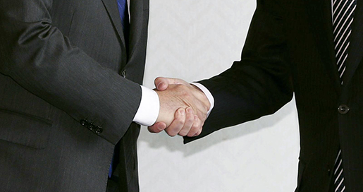 Italian Foreign Minister Paolo Gentiloni, left, and Japanese counterpart Fumio Kishida shake hands during their meeting on the sidelines of meetings by foreign ministers from the Group of Seven industrialized countries, in Hiroshima, western Japan Sunday, April 10, 2016. (Yuta Omori/Kyodo News via AP) JAPAN OUT, MANDATORY CREDIT