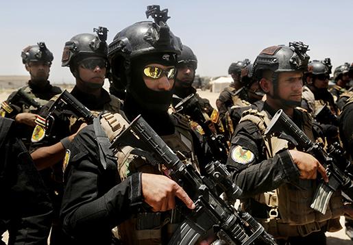 Irakiska elittrupper samlas inför anfallet mot al-Falluja. Foto: AP/Khalid Mohammed