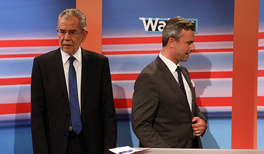 Alexander Van der Bellen candidate of the Austrian Greens, left, and Norbert Hofer, candidate for president of Austria's Freedom Party, FPOE, wait during the release of the election results of the Austria presidential elections in Vienna, Austria, Sunday, May 22, 2016. Nearly final results for Austria's presidential election Sunday showed a right-wing politician neck-to-neck race with a challenger whose views stand in direct opposition to his rival's anti-immigrant and Eurosceptic message. (AP Photo/Ronald Zak)
