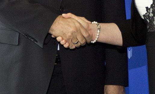 Turkey's president Recep Tayyip Erdogan, left, and his Croatian counterpart Kolinda Grabar-Kitarovic shake hands in Zagreb, Croatia, Tuesday, April 26, 2016. President Erdogan is on two day state visit to Croatia. (AP Photo/Darko Bandic)
