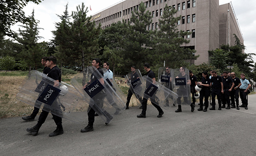 Turkish riot police officers arrive to take positions at the courthouse where prosecutors are questioning hundreds of coup plotters, in Ankara, Turkey, Wednesday, July 20, 2016. Turkey's National Security Council is holding an emergency meeting following a coup attempt last week that was derailed by security forces and protesters loyal to the government. President Recep Tayyip Erdogan was heading the meeting Wednesday of the council, which is the highest advisory body on security issues. (AP Photo/Burhan Ozbilici)