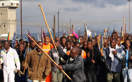 Mine workers sing and dance as they welcome their colleagues after they were released from prison, at Lonmin Platinum Mine near Rustenburg, South Africa, Thursday, Sept. 6, 2012. The second batch of mineworkers arrested following violence at Marikana were released in the Ga-Rankuwa Magistrate's Court on Thursday, after charges of murder and attempted murder were withdrawn. (AP Photo/Themba Hadebe)