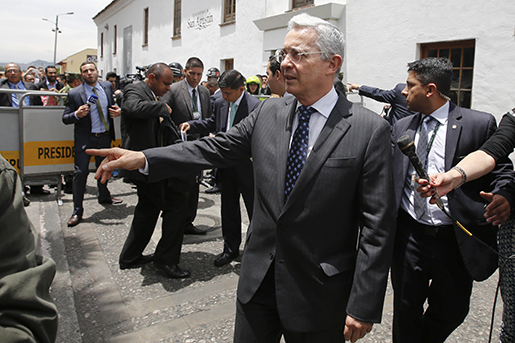 ColombiaǃÙs former President Alvaro Uribe arrives to meet President Juan Manuel Santos in Bogota, Colombia, Wednesday, Oct. 4, 2016. Uribe was a vocal critic of a peace deal signed between Santos and rebels of the Revolutionary Armed Forces of Colombia, FARC, and led a successful campaign for voters that narrowly reject the deal in a referendum. on Oct. 2. (AP Photo/Fernando Vergara)