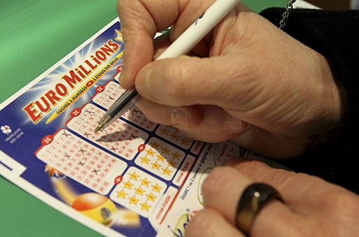 A woman fills out an Euromillion lottery ticket in Bayonne, southwestern France, Friday Feb.12, 2010. Millions of Europeans will chase incredible odds in a bid to win the 129 million euros,  jackpot. (AP Photo/Bob Edme)