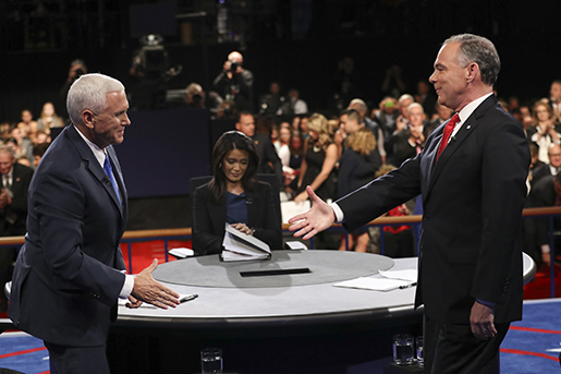 Republican vice-presidential nominee Gov. Mike Pence and Democratic vice-presidential nominee Sen. Tim Kaine, right, shake hands after the vice-presidential debate at Longwood University in Farmville, Va., Tuesday, Oct. 4, 2016. (Joe Raedle/Pool via AP)