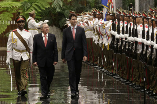 Cuba's President Raul Castro, left, and Canada Prime Minister Justin Trudeau,  review troops during a welcoming ceremony at Revolution Palace in Havana, Cuba, Tuesday, Nov. 15, 2016. Trudeau is on a two-day official visit to Cuba .(Enrique de la Osa/Pool via AP)