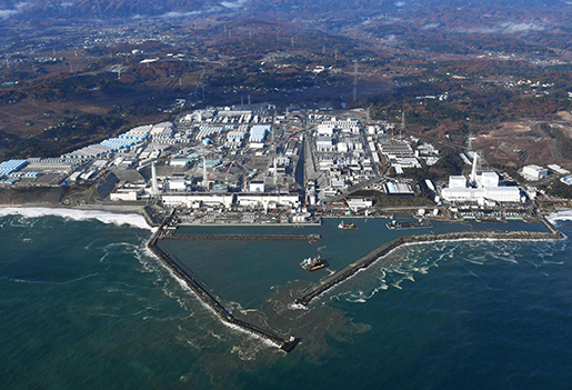 This aerial photo shows Fukushima Dai-ichi nuclear power plant in Okuma, Fukushima Prefecture, following a strong earthquake hit off the coast of Fukushima, northern Japan, Tuesday, Nov. 22, 2016. The operator of the plant, which was swamped by the 2011 tsunami, sending three reactors into meltdown and leaking radiation into the surrounding area, said there were no abnormalities observed at the plant, though a swelling of the tide of up to 1 meter was detected offshore. (Kyodo News via AP)