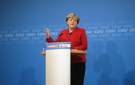 German Chancellor and chairwoman of the Christian Democratic party, CDU, Angela Merkel, addresses the media in Berlin, Germany, Sunday, Nov. 20, 2016. Chancellor Merkel said that she will run for a fourth four-year-term to become one of the longest-serving leaders of post-war Germany. (AP Photo/Markus Schreiber)