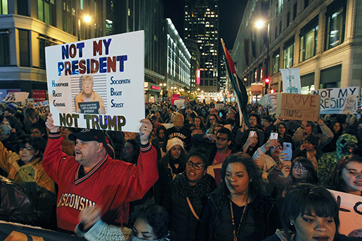 Anti-Trump protesters march on Wisconsin Avenue in Milwaukee to protest president-elect, Donald Trump, Thursday, Nov. 10, 2016. Demonstrators in both red and blue states hit the streets for another day Thursday to express their outrage over Donald Trump's unexpected win, while the president-elect sniped back in a Twitter post. (Pat A. Robinson/Milwaukee Journal-Sentinel via AP)