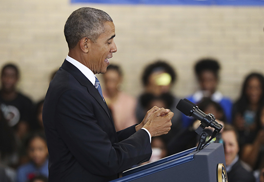 President Barack Obama mimics texting on a smart phone as he speaks to students, teachers and invited guests at Benjamin Banneker Academic High School in Washington, Monday, Oct. 17, 2016, to highlight the progress his administration has made over the last eight years to improve education across the country. (AP Photo/Manuel Balce Ceneta)