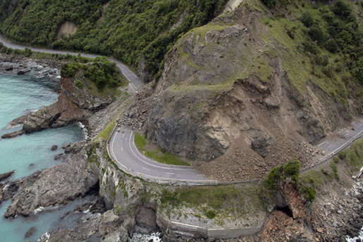 A landslide covers a section of state highway 1 near Kaikoura, New Zealand, Monday, Nov. 14, 2016, after a powerful earthquake. A powerful earthquake that rocked New Zealand on Monday triggered landslides and a small tsunami, cracked apart roads and homes, but largely spared the country the devastation it saw five years ago when a deadly earthquake struck the same region. (David Alexander/SNPA via AP)