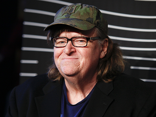 "FILE - In this May 16, 2016 file photo, Michael Moore attends the 20th Annual Webby Awards at Cipriani Wall Street in New York. Moore premiered a surprise film about the U.S. presidential election on Tuesday, Oct. 18, 2016. ""Michael Moore in TrumpLand"" features a one-man stage show of Moore discussing the race. (Photo by Andy Kropa/Invision/AP, File)"