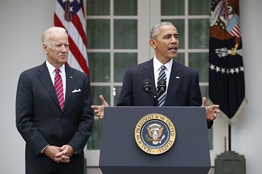 President Barack Obama, accompanied by Vice President Joe Biden, speaks in the election, Wednesday, Nov. 9, 2016, in the Rose Garden of the White House in Washington. (AP Photo/Pablo Martinez Monsivais)