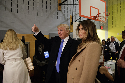 Republican presidential candidate Donald Trump, with his wife Melania, gestures after casting his ballot at PS-59, Tuesday, Nov. 8, 2016, in New York. (AP Photo/ Evan Vucci)