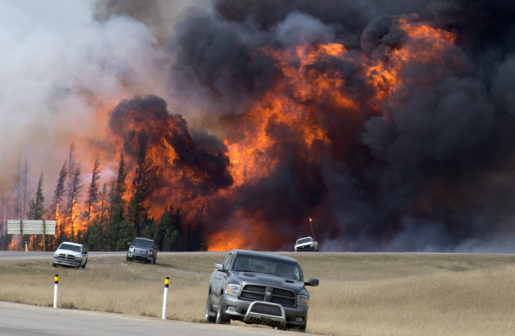 FILE - In this May 7, 2016 file photo, a wildfire burns south of Fort McMurray, Alberta. A dry and blistering hot northern Alberta is burning and doing so unusually early in the year, but thatís only the latest of many gargantuan fires on an Earth thatís grown hotter with more extreme weather. (Jonathan Hayward /The Canadian Press via AP, File) MANDATORY CREDIT